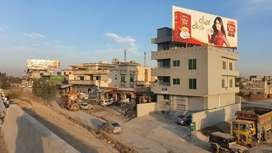 Main KASHMIR HIGHWAY Plaza for rent flats, offices, shops, and hall.