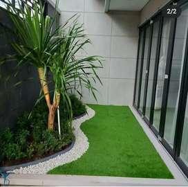 Pembuatan taman rumput sintetis