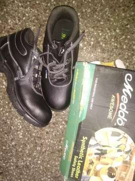 Black synthetic leather shoes