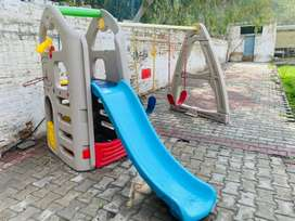 Imported swings with slide