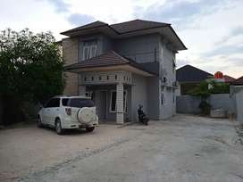 Rumah kost di area perkantoran