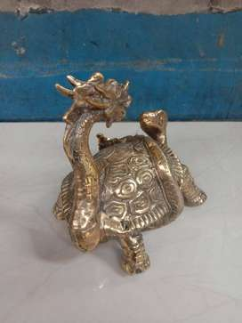 Patung dewa kura kura naga