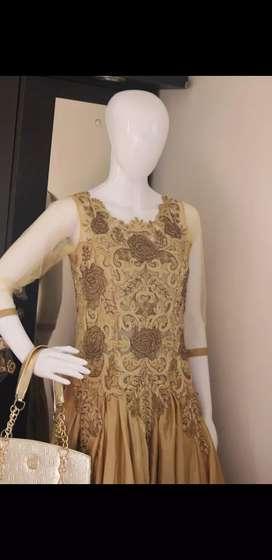 Brown silk gown.
