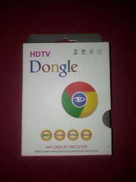 Dongle, alat prnyambung layar hp ke tv.