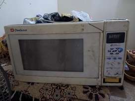 Original dawlance oven is for sale or exchange with small oven.