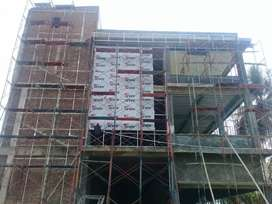 Barang Acp yg kuat dan tahan lama tertera di dinding gedung
