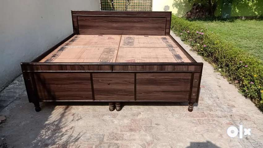 Unused new wooden double bed with box available