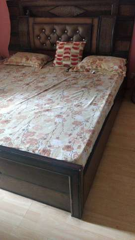 Hardly used good quality wooden bed with storage