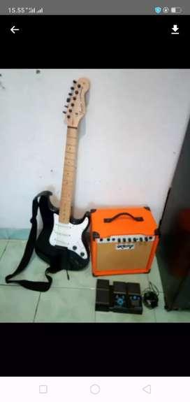 Satu set gitar stratocaster ampli dan pedal