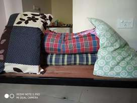 Single bed cot with mattress pillow and bedsheet