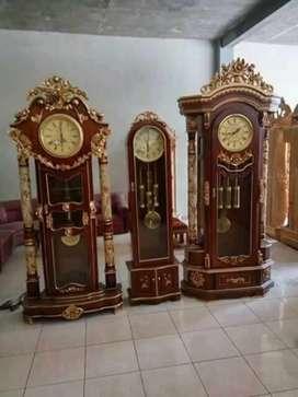 Lemari jam kayu jati masjid agung sultan qaboos