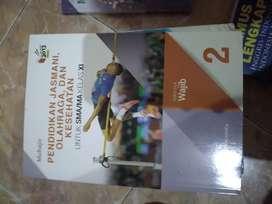 Buku Penjas kls 11 bekas mulus like new