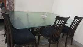 6 chair Dinning table glass and wooden.