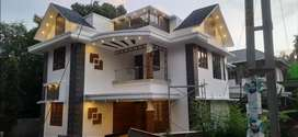 A STUNNING NEW 4BED ROOM 6.150CENTS 2020SQ FT HOUSE IN THALORE,THRISUR