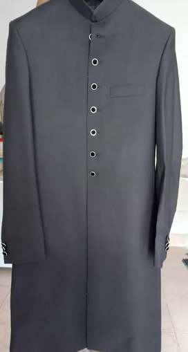 Balck sherwani.only one time used.with white inner