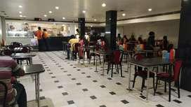 Machine operator at fast food parlour