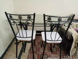A one table of iron and it has four chairs