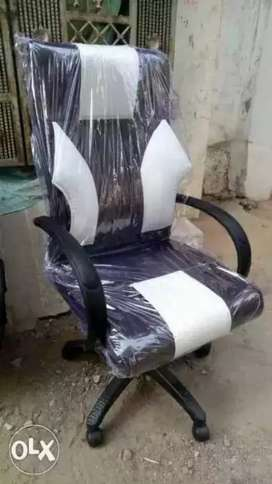 White black office chairs and office table available