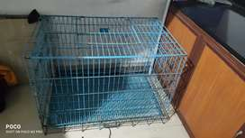 Foldable dog cage for sale.