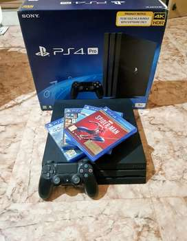 PS-4 PRO 1-TB EXCELLENT CONDITION WITH 4 GAMES AND TWO CONTROLLER