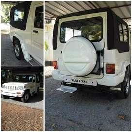 BOLERO INVADER Jeep,White colour,A/C,company service, good condition .