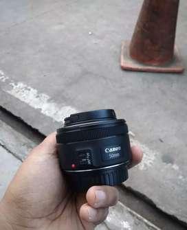 Lensa fix 50mm stm Canon af mf normal akurat.