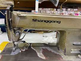 Sewing machine with motor and stand