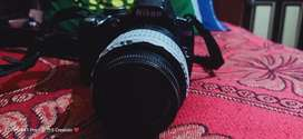 Nikon d3000 with battery, charger, bag and 4gb memory card