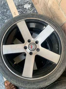 17 inch alloy rims with three good condition tyres
