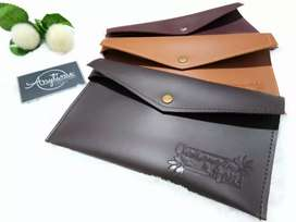 Clutch leather embos