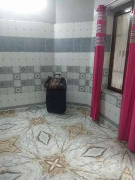 One single room bed almirah Ac facility separate toilet .