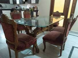 Little used, almost new, large designer dining table with 6 chairs
