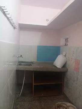 One room set with attached kitchen