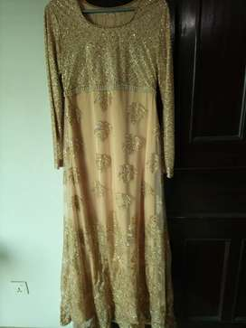 Golden fancy maxi With silk inner attached with golden net dupatta