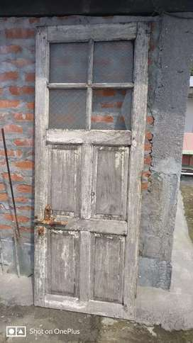 2ft x 6ft old door with glass panel. Medium condition.