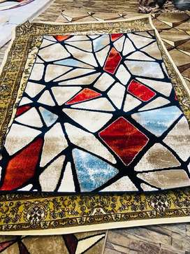 Rugs and centre peices of all kinds available at bukhari interior LTD