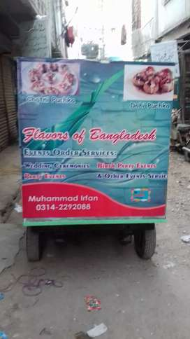 Auto rikshaw with burger chaat stall.