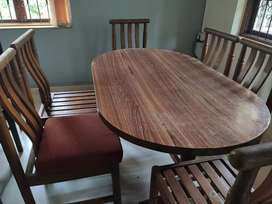 Wooden dining table with 6
