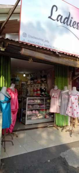 Over kontrak toko pakaian beserta isi