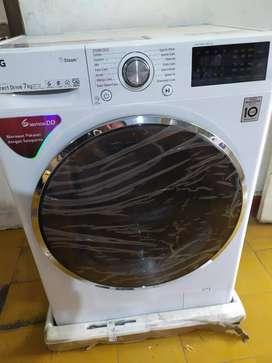 lg mesin cuci front loading 7kg fc1207s3w baru