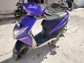 Honda dio violet colour.