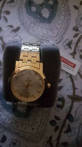 gold plated brand new titan watch