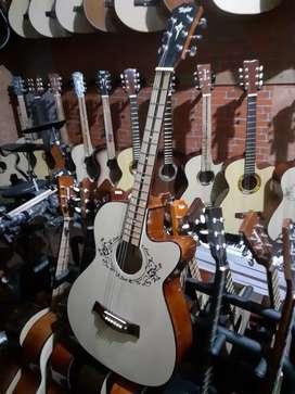 Gitar akustik taylor tanam besi