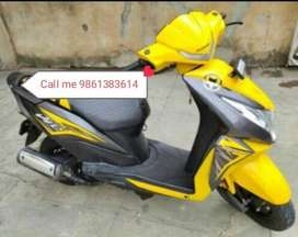 Yellow colour scooty
