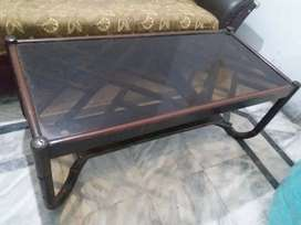 Brown glass top table in 9/10 condition