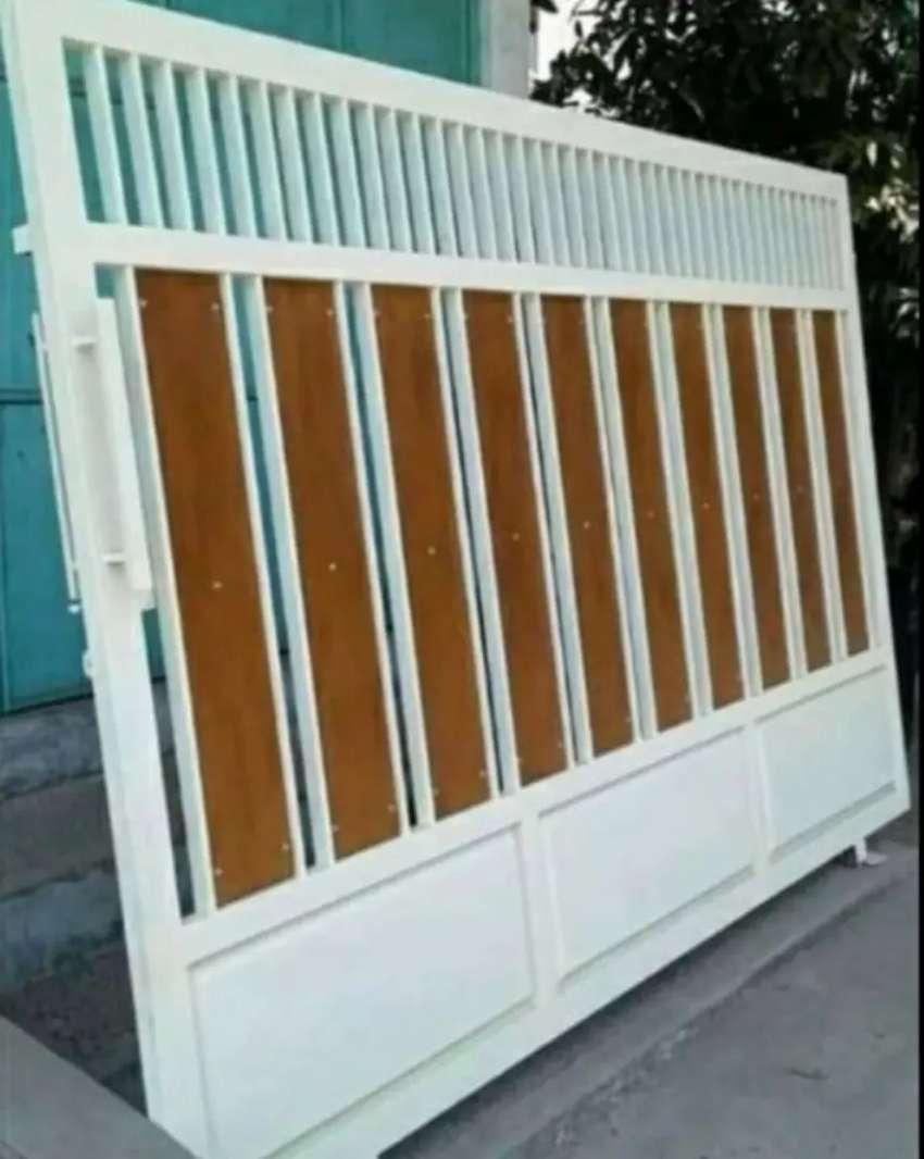 Kami bengkel las nerimah pemasangan pagar grc motif kayu @@4809