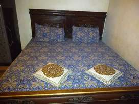 King size wooden bed with side tables