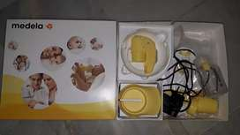 Medela MINI electric pump BRAND NEW WITH UNUSED FILTER