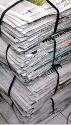 Membeli Koran Bekas