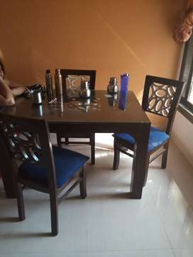 Wooden Dinning table glass top with 4  chairs wooden
